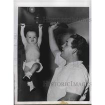 1947 Press Photo 9 month old Robert Becker & dad Kenneth work out - nea38073