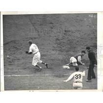 1947 Press Photo Rip Sewell of Pirates Slides Back to First, Ed Waitkus of Cubs