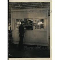 1931 Press Photo Man Walking Through Filming Set On Akron Ohio