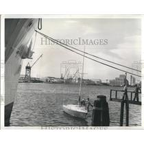 Press Photo The Red Baron finally makes it to dock as the Coast Guard stand by