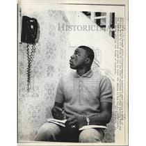 1966 Press Photo Basketball star sits, awaiting a phone call.