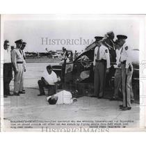 1962 Press Photo Unidentified spectator who was struck by wing lost by plan