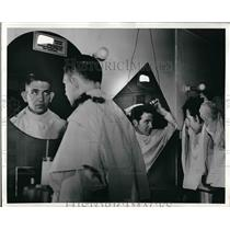 1942 Press Photo Aviation Cadet John L. Chadwick Looking At Hairstyle In Mirror