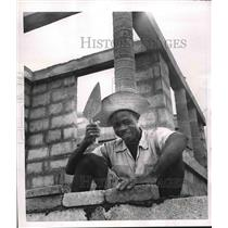 1951 Press Photo Part-Au-Prince, Haita. construction worker laying bricks