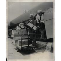1931 Press Photo Bleuher Company Pilot Loading Timepieces onto Airplane
