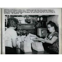 1967 Press Photo Workers stack New York State Lottery tickets at Moore Business