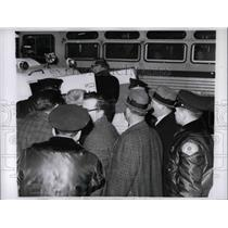 Press Photo Dominic Abata, head of Taxicab Union, being put in Patrol Wagon