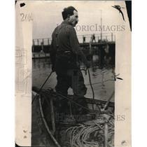 1923 Press Photo A man on his coastal fishing boat - nea84652