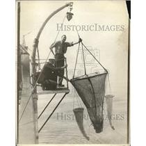 1923 Press Photo Fishermen tossing their nets over side of a boat