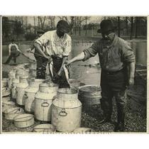 1925 Press Photo Men Place Trout In Milk Cans - nea78318