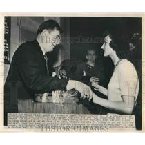 1949 Press Photo Passenger Agent George Coulter explained the plane cannot fly.