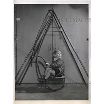 1945 Press Photo Joel Linderath of Chicago on a metal swing set