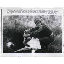 1960 Press Photo Patrolman Covers Body of Woman Thrown From Plane Wreck