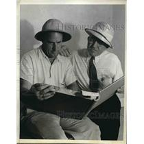 1938 Press Photo Flying Instructors Doug Kelley JJ Red Harrigan Reading Maps
