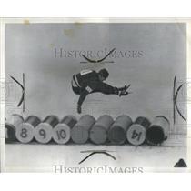 1963 Press Photo Detroit Fireman Jumping Barrels Skates - RRS84109