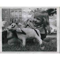1945 Press Photo Child Playing With Sheep Toy In Park