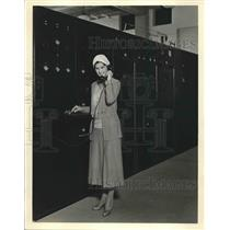 1931 Press Photo Model Demonstrates the Telephone and Telegraph Communications