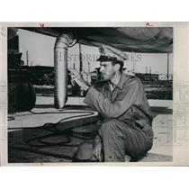 1945 Press Photo Maj. A. Otterson inspects bomb bay of B-25 Bomber