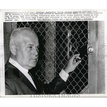1966 Press Photo Montreal Postmaster Hector Cormier examine wire cut by thieves.