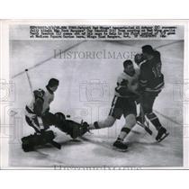 1958 Press Photo Red Wings Al Arbour blocks Rangers Guy Gendron, goalie sawchuk
