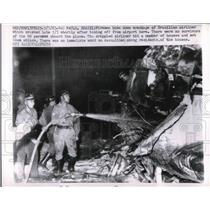 1963 Press Photo Firemen Hose Down Wreckage of Brazilian Airliner Crashed