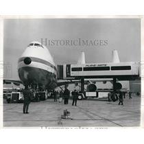 1970 Press Photo A plane and Plane Mate loading ramp at an airport - neb09150