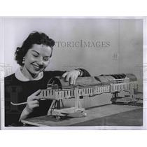 1956 Press Photo Woman demonstrating Aerobridge for air planes