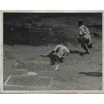1939 Press Photo Brooklyn catcher Babe Phelps falling to the ground at home