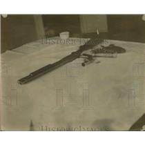 1928 Press Photo Guns Left Behind by Bandits