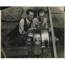 1929 Press Photo Two men working with manufacturing machines