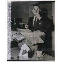 1934 Press Photo Reporter tasting government made butter in Washington