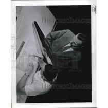 1961 Press Photo Lewis Lab engineers check airplane designs at research labs