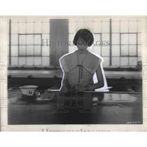 1927 Press Photo A Goodyear Rubber Co employee in Akron, Ohio