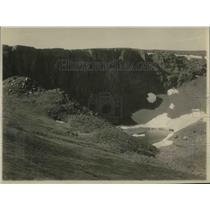 1925 Press Photo Side of Mountain Reveals Crystal Clear Pool Caused By Snowmelt
