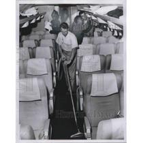 1960 Press Photo Cleaning Cabinet of AA Boeing jet