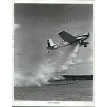 "1965 Press Photo Test of ""Quick-dump Valve"" of a new Cessna Agwagon in Wichita"