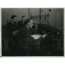 1931 Press Photo Broadcasters Sit At Dramatic Control Panel In Studio