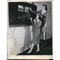 1944 Press Photo Stewardesses Leany and Hannifin Compare Wright Plane Pictures