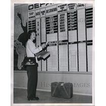 1947 Press Photo Lucyee Shoaff Checks ATC Departure Board For Flight To Japan