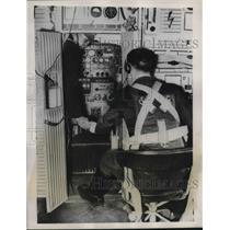 1939 Press Photo Radio Operator in School's Training Plane Relaying Message