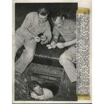 1948 Press Photo William Royse Stays in Storm Sewer All Night to win Bet