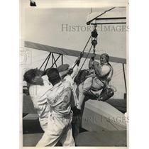 1929 Press Photo Bernard West Passes Exam At Aero Corporation, Hoisted