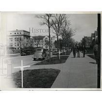 1935 Press Photo Scene Of Men Walking Sidewalks Along a Street