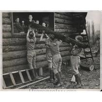 1934 Press Photo Boys Scout helping hand in hand in building a log cabin