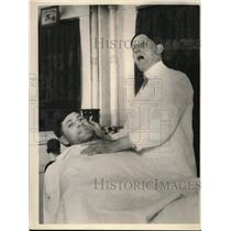 1926 Press Photo Oscar Dosteel Gets Cut By Barber