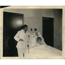 1929 Press Photo Child LIstens To Radio With Headphones In Hospital Bed