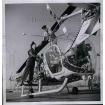 1954 Press Photo Airmen & Bell HTL-5 helicopter on icebreaker Atka