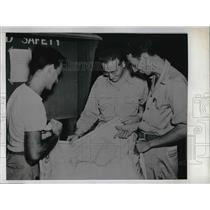 1945 Press Photo Crew Members of Super-Fortress in Guam checked their Maps.