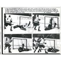 1961 Press Photo Detroit, Goalie Glen Hall shows different saves in game vs