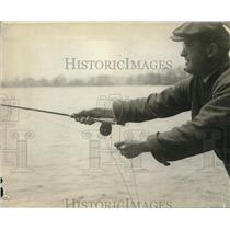 1919 Press Photo Man fishing in the docks